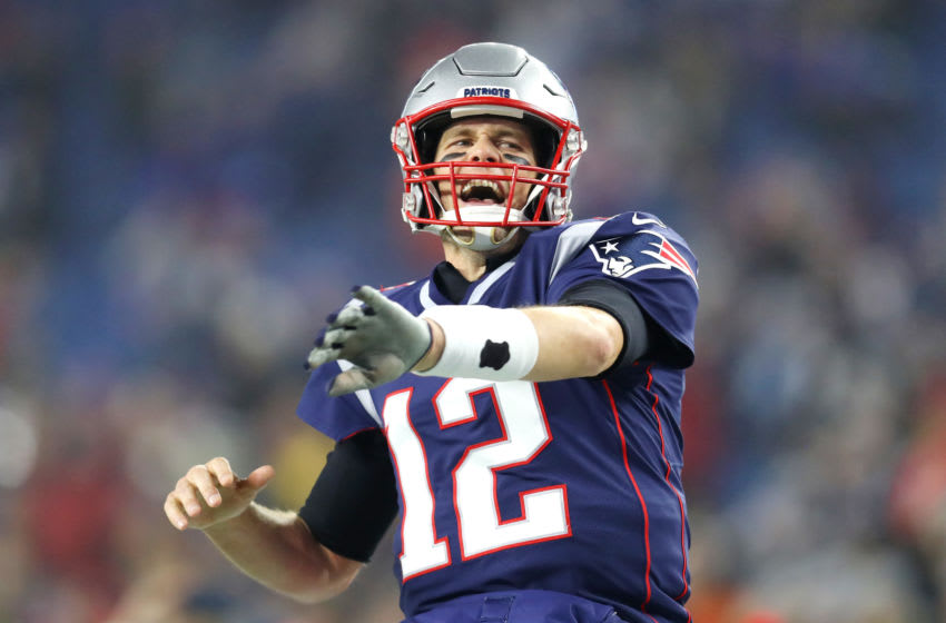 FOXBOROUGH, MASSACHUSETTS - JANUARY 04: Tom Brady #12 of the New England Patriots reacts as he runs onto the field before the AFC Wild Card Playoff game against the Tennessee Titans at Gillette Stadium on January 04, 2020 in Foxborough, Massachusetts. (Photo by Maddie Meyer/Getty Images)