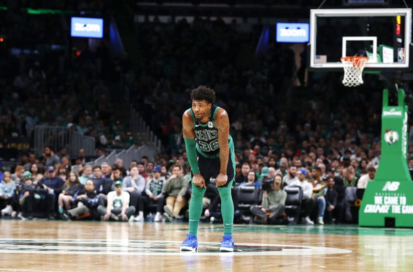 BOSTON, MASSACHUSETTS - MARCH 08: Marcus Smart #36 of the Boston Celtics looks on during the third quarter of the game against the Oklahoma City Thunder at TD Garden on March 08, 2020 in Boston, Massachusetts. NOTE TO USER: User expressly acknowledges and agrees that, by downloading and or using this photograph, User is consenting to the terms and conditions of the Getty Images License Agreement. (Photo by Omar Rawlings/Getty Images)