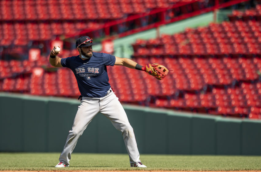BOSTON, MA - JULY 16: Jose Peraza #3 of the Boston Red Sox throws during an intra squad game during a summer camp workout before the start of the 2020 Major League Baseball season on July 16, 2020 at Fenway Park in Boston, Massachusetts. The season was delayed due to the coronavirus pandemic. (Photo by Billie Weiss/Boston Red Sox/Getty Images)