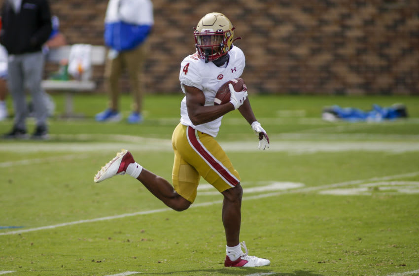 DURHAM, NORTH CAROLINA - SEPTEMBER 19: Boston College Eagles wide receiver Zay Flowers looks back as he runs for a touchdown after a catch against the Duke Blue Devils in the third quarter at Wallace Wade Stadium on September 19, 2020 in Durham, North Carolina. The Boston College Eagles won 26-6.(Photo by Nell Redmond-Pool/Getty Images)