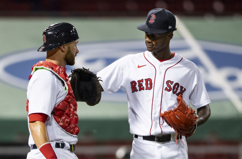 BOSTON, MA - JULY 24: Phillips Valdez #71 of the Boston Red Sox reacts with Jonathan Lucroy #12 after a victory during the Opening Day game against the Baltimore Orioles on July 24, 2020 at Fenway Park in Boston, Massachusetts. The 2020 season had been postponed since March due to the COVID-19 pandemic. (Photo by Billie Weiss/Boston Red Sox/Getty Images)