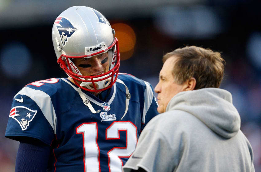 FOXBORO, MA - JANUARY 13: Tom Brady #12 of the New England Patriots stands on the field with head coach Bill Belichick of the New England Patriots prior to playing against the Houston Texans during the 2013 AFC Divisional Playoffs game at Gillette Stadium on January 13, 2013 in Foxboro, Massachusetts. (Photo by Jim Rogash/Getty Images)