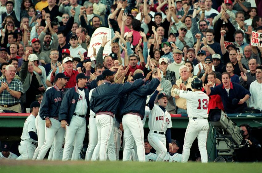16 Oct 1999: John Valentin #13 of the Boston Red Sox celebrates with teammates during the ALCS game three against the New York Yankees at Fenway Park in Boston, Massachusetts. The Red Sox defeated the Yankees 13-1. Mandatory Credit: Jonathan Daniel /Allsport