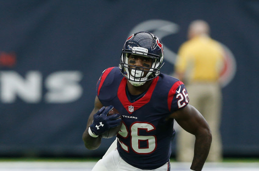 HOUSTON, TX - SEPTEMBER 18: Lamar Miller #26 of the Houston Texans rushes in the first half against the Kansas City Chiefs at NRG Stadium on September 18, 2016 in Houston, Texas. (Photo by Bob Levey/Getty Images)
