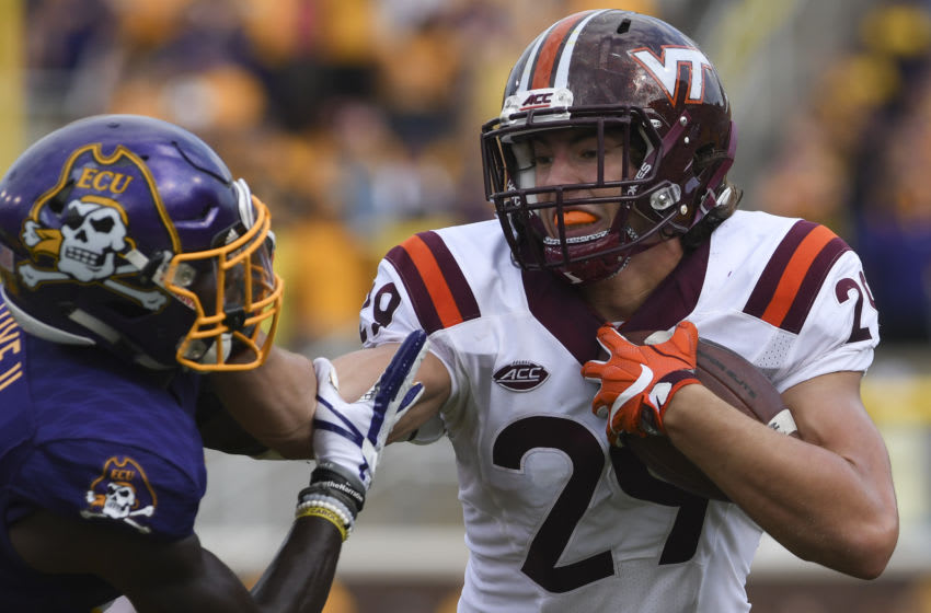 GREENVILLE, NC - SEPTEMBER 16: Tight end Dalton Keene #29 of the Virginia Tech Hokies stiff arms defensive back Chris Love #35 of the East Carolina Pirates in the first half at Dowdy-Ficklen Stadium on September 16, 2017 in Greenville, North Carolina. Virginia Tech defeated East Carolina 64-17. (Photo by Michael Shroyer/Getty Images) *** Dalton Keene; Chris Love