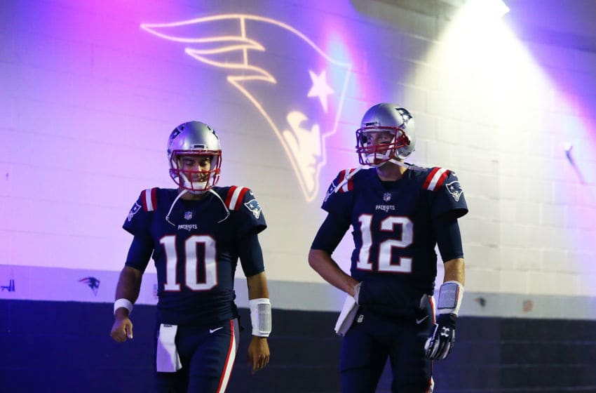 FOXBORO, MA - OCTOBER 22: Tom Brady #12 and Jimmy Garoppolo #10 of the New England Patriots walk through the tunnel before a game against the Atlanta Falcons at Gillette Stadium on October 22, 2017 in Foxboro, Massachusetts. (Photo by Adam Glanzman/Getty Images)