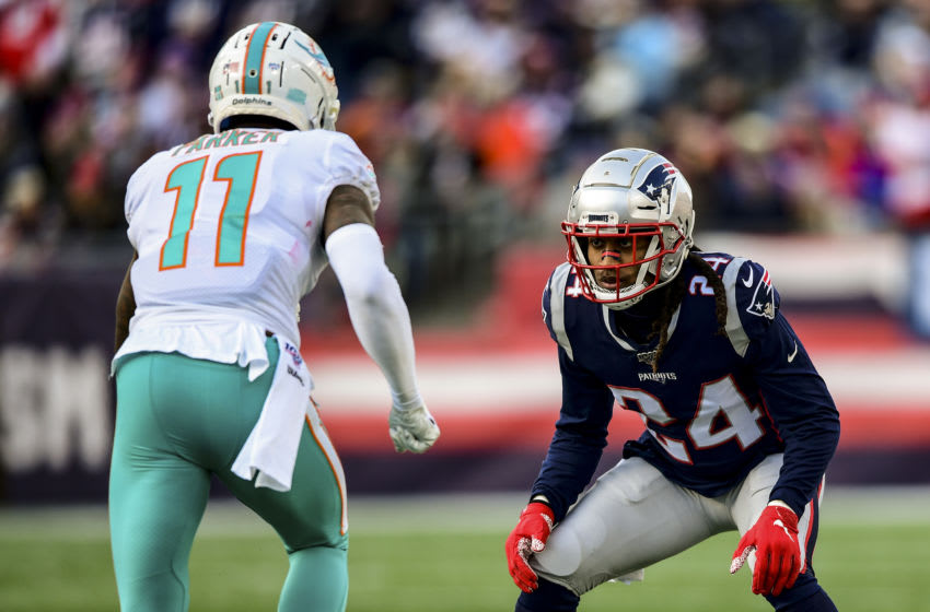 FOXBOROUGH, MA - DECEMBER 29: Stephon Gilmore #24 of the New England Patriots looks on during the second quarter of a game against the Miami Dolphins at Gillette Stadium on December 29, 2019 in Foxborough, Massachusetts. (Photo by Billie Weiss/Getty Images)