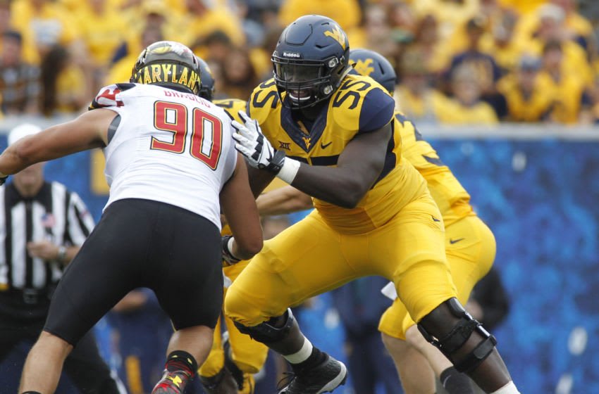 MORGANTOWN, WV - SEPTEMBER 26: Yodny Cajuste #55 of the West Virginia Mountaineers in action during the game against the Maryland Terrapins on September 26, 2015 at Mountaineer Field in Morgantown, West Virginia. (Photo by Justin K. Aller/Getty Images)