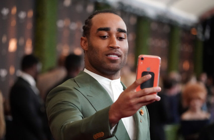Feb 1, 2020; Miami, Florida, USA; New England Patriots Stephon Gilmore takes a selfie on the red carpet prior to the NFL Honors awards presentation at Adrienne Arsht Center. Mandatory Credit: Kirby Lee-USA TODAY Sports