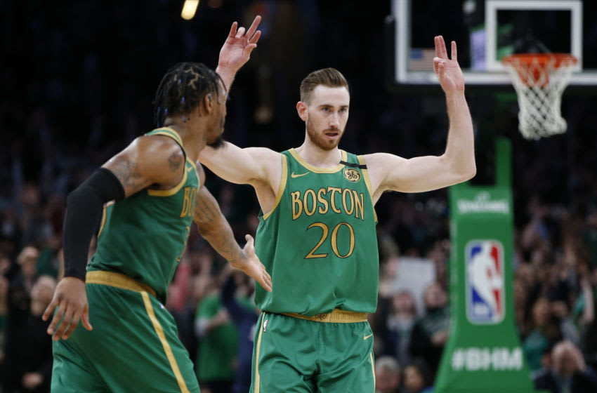 Feb 13, 2020; Boston, Massachusetts, USA; Boston Celtics guard Gordon Hayward (20) celebrates with guard Marcus Smart (36) after a three point basket during the second overtime at TD Garden. Mandatory Credit: Greg M. Cooper-USA TODAY Sports