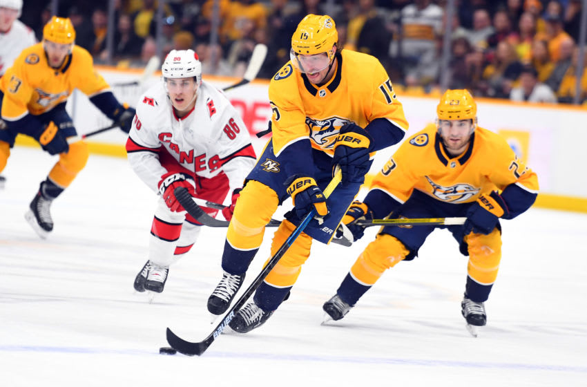 Feb 18, 2020; Nashville, Tennessee, USA; Nashville Predators right wing Craig Smith (15) skates the puck into the offensive zone during the first period against the Carolina Hurricanes at Bridgestone Arena. Mandatory Credit: Christopher Hanewinckel-USA TODAY Sports