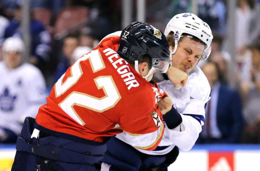 Feb 27, 2020; Sunrise, Florida, USA; Florida Panthers defenseman MacKenzie Weegar (52) fights Toronto Maple Leafs right wing Kasperi Kapanen (24) during the first period of the game at BB&T Center. Mandatory Credit: Sam Navarro-USA TODAY Sports