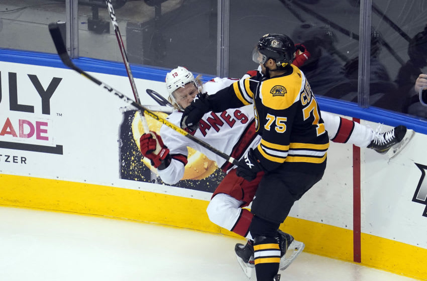 Aug 19, 2020; Toronto, Ontario, CAN; Boston Bruins defenseman Connor Clifton (75) hits Carolina Hurricanes center Ryan Dzingel (18) during the first period in game five of the first round of the 2020 Stanley Cup Playoffs at Scotiabank Arena. Mandatory Credit: John E. Sokolowski-USA TODAY Sports