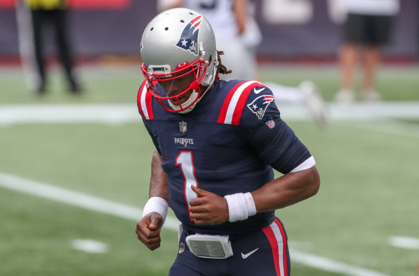 Sep 27, 2020; Foxborough, Massachusetts, USA; New England Patriots quarterback Cam Newton (1) reacts during the first half against the Las Vegas Raiders at Gillette Stadium. Mandatory Credit: Paul Rutherford-USA TODAY Sports