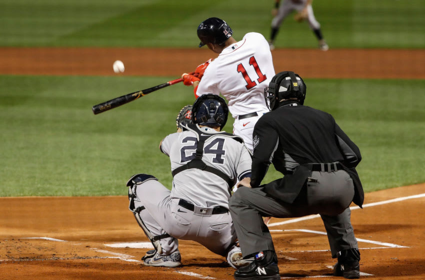 Sep 18, 2020; Boston, Massachusetts, USA; Boston Red Sox third baseman Rafael Devers (11) swings against the New York Yankees during the first inning at Fenway Park. Mandatory Credit: Winslow Townson-USA TODAY Sports