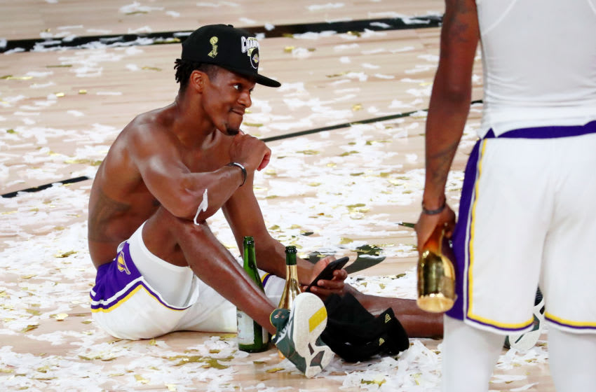 Oct 11, 2020; Lake Buena Vista, Florida, USA; Los Angeles Lakers guard Rajon Rondo (9) sits on the court after game six of the 2020 NBA Finals at AdventHealth Arena. The Los Angeles Lakers won 106-93 to win the series. Mandatory Credit: Kim Klement-USA TODAY Sports