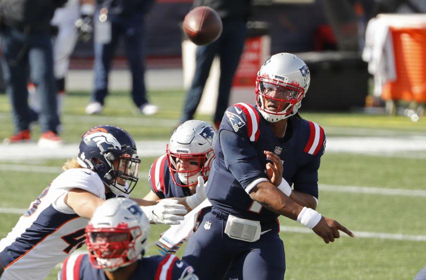 Oct 18, 2020; Foxborough, Massachusetts, USA; New England Patriots quarterback Cam Newton (1) throws under pressure from Denver Broncos linebacker Derrek Tuszka (48) during the second quarter at Gillette Stadium. Mandatory Credit: Winslow Townson-USA TODAY Sports
