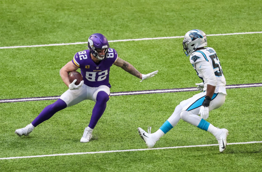 Nov 29, 2020; Minneapolis, Minnesota, USA; Minnesota Vikings tight end Kyle Rudolph (82) carries the ball during the third quarter against the Carolina Panthers at U.S. Bank Stadium. Mandatory Credit: Brace Hemmelgarn-USA TODAY Sports