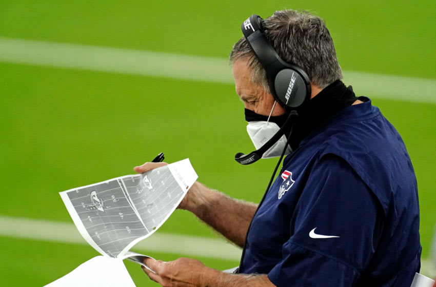 Dec 10, 2020; Inglewood, California, USA; New England Patriots head coach Bill Belichick looks at different plays during the first half against the Los Angeles Rams at SoFi Stadium. Mandatory Credit: Kirby Lee-USA TODAY Sports