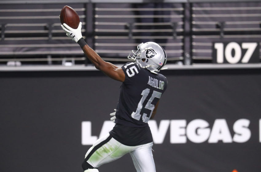 Dec 26, 2020; Paradise, Nevada, USA; Las Vegas Raiders wide receiver Nelson Agholor (15) celebrates a touchdown against the Miami Dolphins at Allegiant Stadium. Mandatory Credit: Mark J. Rebilas-USA TODAY Sports