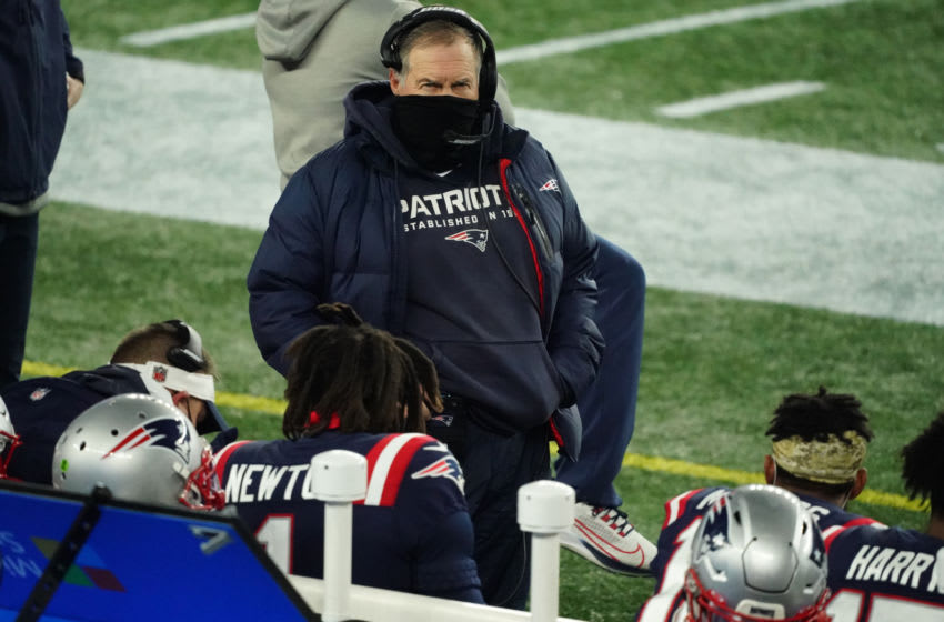 Dec 28, 2020; Foxborough, Massachusetts, USA; New England Patriots head coach Bill Belichick talks with quarterback Cam Newton (1) on the sideline as they take on the Buffalo Bills in the first quarter at Gillette Stadium. Mandatory Credit: David Butler II-USA TODAY Sports