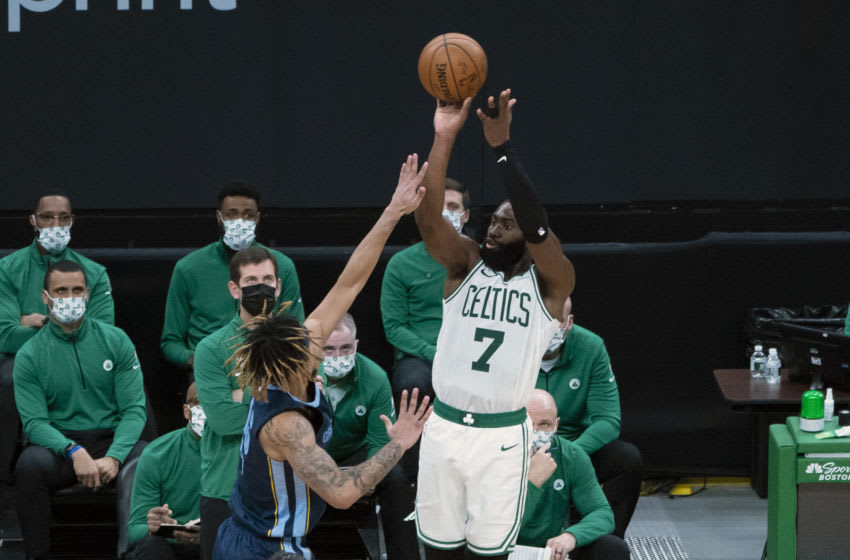 Dec 30, 2020; Boston, Massachusetts, USA; Boston Celtics shooting guard Jaylen Brown (7) shoots a three point jump shot against the Memphis Grizzlies during the third quarter at TD Garden. Mandatory Credit: Gregory Fisher-USA TODAY Sports