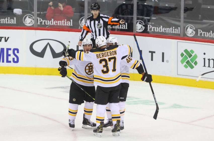 Jan 14, 2021; Newark, New Jersey, USA; The Boston Bruins celebrate a goal by Boston Bruins center Brad Marchand (63) during the first period at Prudential Center. Mandatory Credit: Ed Mulholland-USA TODAY Sports