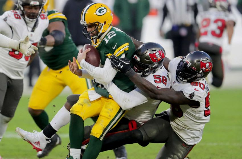 Packers quarterback Aaron Rodgers (12) is sacked by Buccaneers Shaquil Barrett (58) and Jason Pierre-Paul during the 4th quarter of the Green Bay Packers 31-26 loss to Tampa Bay Bin the NFC championship game. Usp Nfl Nfc Championship Game Tampa Bay Buccaneer A Rac Usa Wi