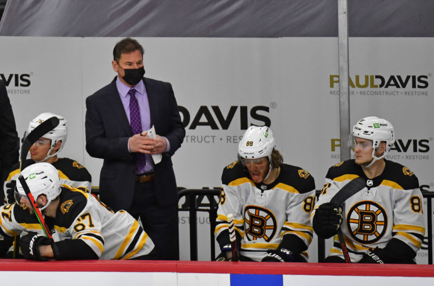 Feb 5, 2021; Philadelphia, Pennsylvania, USA; Boston Bruins head coach Bruce Cassidy bending the bench against the Philadelphia Flyers during the third period at Wells Fargo Center. Mandatory Credit: Eric Hartline-USA TODAY Sports