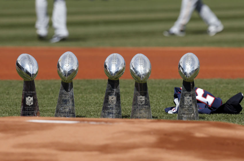 Apr 3, 2017; Boston, MA, USA; The New England Patriots Super Bowl trophies on the field prior to the Opening Day game between the Pittsburgh Pirates and the Boston Red Sox at Fenway Park. Mandatory Credit: Greg M. Cooper-USA TODAY Sports
