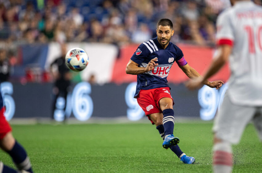 Jul 7, 2021; Foxborough, Massachusetts, USA; New England Revolution midfielder Carles Gil (22) scores a goal off of a free kick during the second half against the Toronto FC at Gillette Stadium. Mandatory Credit: Paul Rutherford-USA TODAY Sports
