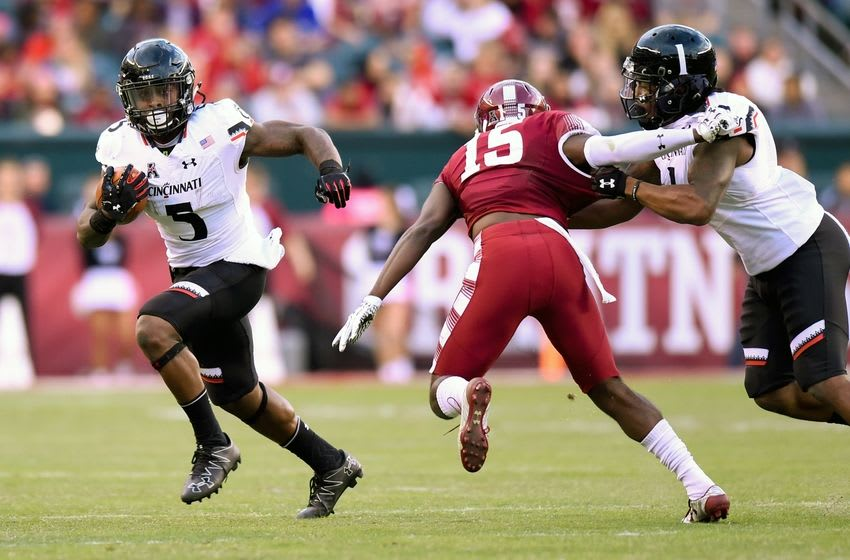 Oct 29, 2016; Philadelphia, PA, USA; Cincinnati Bearcats running back Mike Boone (5) runs with the ball against the Temple Owls during the third quarter at Lincoln Financial Field. Temple defeated Cincinnati 34-13. Mandatory Credit: Rich Barnes-USA TODAY Sports