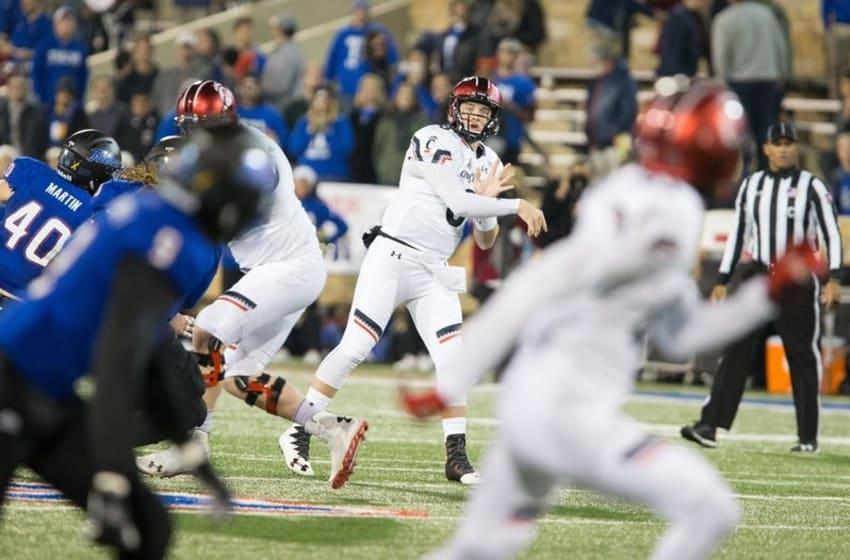 Nov 25, 2016; Tulsa, OK, USA; Cincinnati Bearcats quarterback Hayden Moore (8) throws a touchdown pass downfield to Cincinnati Bearcats wide receiver Thomas Geddis (85) at Skelly Field at H.A. Chapman Stadium. Mandatory Credit: Joey Johnson-USA TODAY Sports