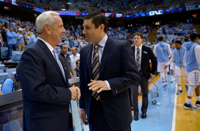 CHAPEL HILL, NC - DECEMBER 28: Head coach Roy Williams of the North Carolina Tar Heels, left, talks with head coach Wes Miller of the UNC-Greensboro Spartans during their game at the Dean Smith Center on December 28, 2015 in Chapel Hill, North Carolina. Miller played on Williams' 2005 national championship team. North Carolina won 96-63. (Photo by Grant Halverson/Getty Images)