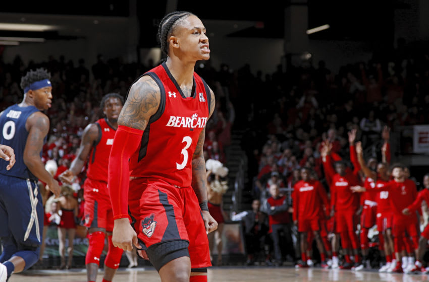 CINCINNATI, OH - DECEMBER 08: Justin Jenifer #3 of the Cincinnati Bearcats reacts after a three-point basket in the first half of the game against the Xavier Musketeers at Fifth Third Arena on December 8, 2018 in Cincinnati, Ohio. Cincinnati won 62-47. (Photo by Joe Robbins/Getty Images)