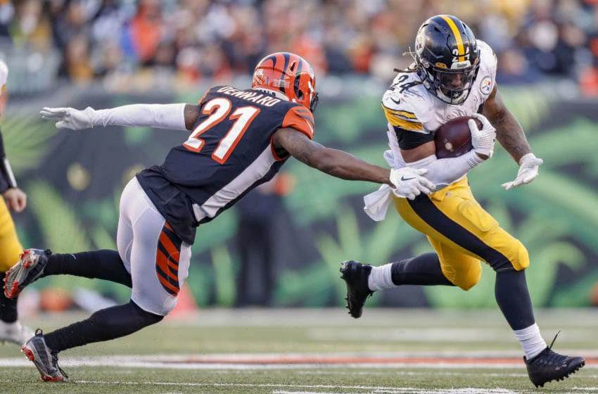 CINCINNATI, OH - NOVEMBER 24: Benny Snell #24 of the Pittsburgh Steelers runs the ball as Darqueze Dennard #21 of the Cincinnati Bengals reaches for the tackle at Paul Brown Stadium on November 24, 2019 in Cincinnati, Ohio. (Photo by Michael Hickey/Getty Images)