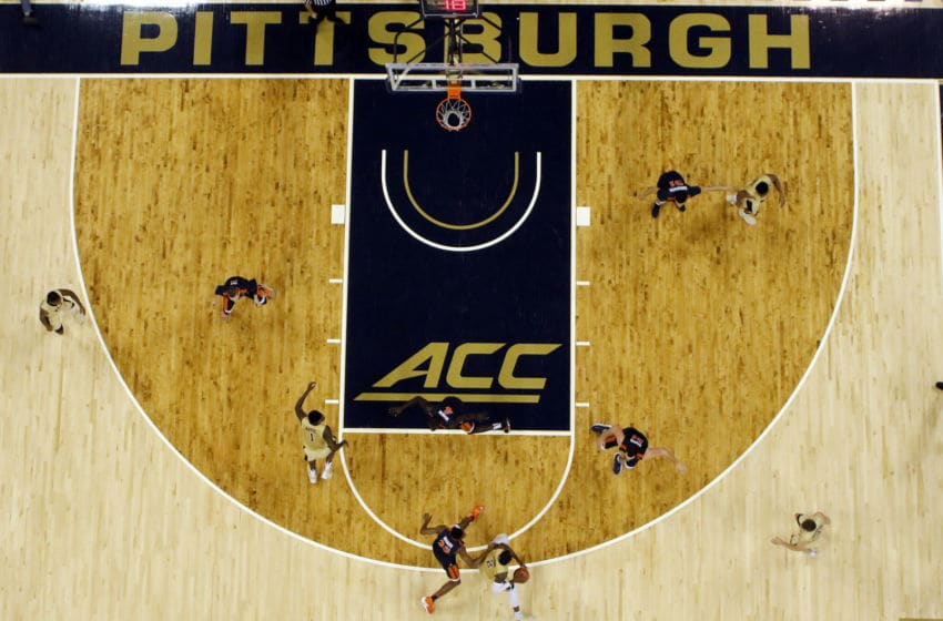 PITTSBURGH, PA - JANUARY 04: Michael Young #2 of the Pittsburgh Panthers handles the ball against Mamadi Diakite #25 of the Virginia Cavaliers at Petersen Events Center on January 4, 2017 in Pittsburgh, Pennsylvania. (Photo by Justin K. Aller/Getty Images)