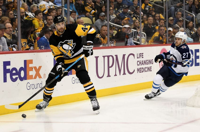 PITTSBURGH, PA - OCTOBER 08: Erik Gudbranson #44 of the Pittsburgh Penguins skates with the puck in the first period during the game against the Winnipeg Jets at PPG PAINTS Arena on October 8, 2019 in Pittsburgh, Pennsylvania. (Photo by Justin Berl/Getty Images)