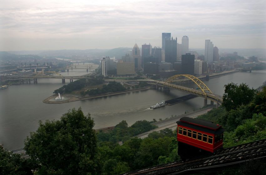 PITTSBURGH - SEPTEMBER 08: A passenger car travels down the Duquesne Incline on September 8, 2008 in Pittsburgh, Pennsylvania. The Duquesne Incline opened in 1877 and is used to carry up to 30 passengers at a time up and down Mt. Washington to various modes of transportation. (Photo by Ronald Martinez/Getty Images)