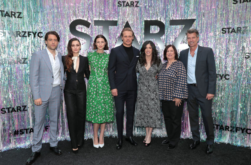 CENTURY CITY, CALIFORNIA - JUNE 02: (L-R) Richard Rankin, Sophie Skelton, Caitriona Balfe, Sam Heughan, Executive Producer Maril Davis, Executive Producer/Writer Toni Graphia and Production Designer Jon Gary Steele attend Starz FYC 2019 — Where Creativity, Culture and Conversations Collide on June 02, 2019 at Westfield Century City in Century City, California. (Photo by Rich Polk/Getty Images for STARZ Entertainment LLC.)