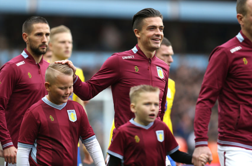 BIRMINGHAM, ENGLAND - NOVEMBER 25: Jack Grealish of Aston Villa walks out onto the pitch with a mascot during the Sky Bet Championship match between Aston Villa and Birmingham City at Villa Park on November 25, 2018 in Birmingham, England. (Photo by Alex Pantling/Getty Images)
