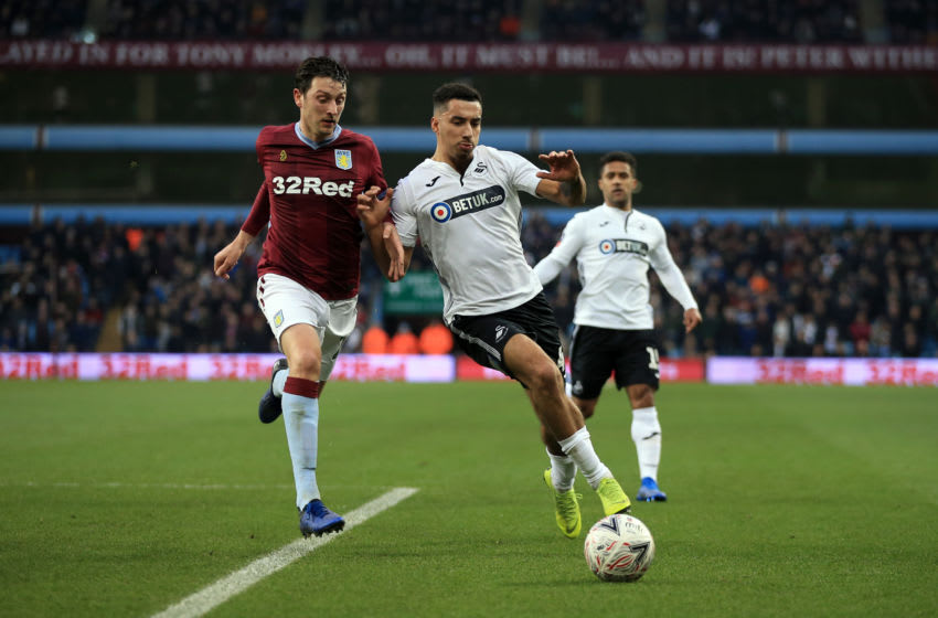 BIRMINGHAM, ENGLAND - JANUARY 05: Courtney Baker-Richardson of Swansea City in action with Tommy Elphick of Aston Villa during the FA Cup Third Round match between Aston Villa and Swansea City at Villa Park on January 5, 2019 in Birmingham, United Kingdom. (Photo by Marc Atkins/Getty Images)