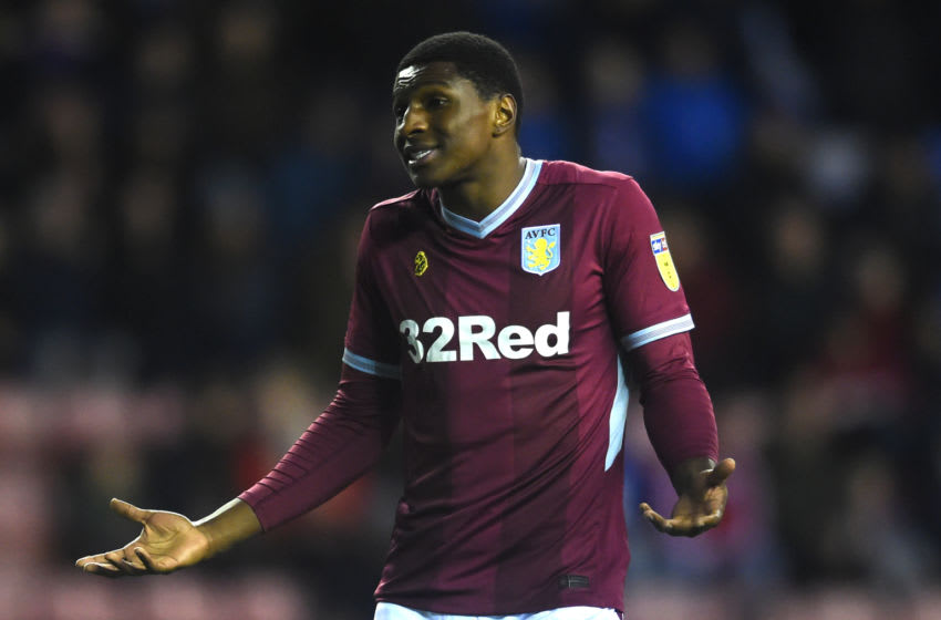 WIGAN, ENGLAND - JANUARY 12: Kortney Hause of Aston Villa questions his team mate during the Sky Bet Championship match between Wigan Athletic and Aston Villa at DW Stadium on January 12, 2019 in Wigan, England. (Photo by Nathan Stirk/Getty Images)