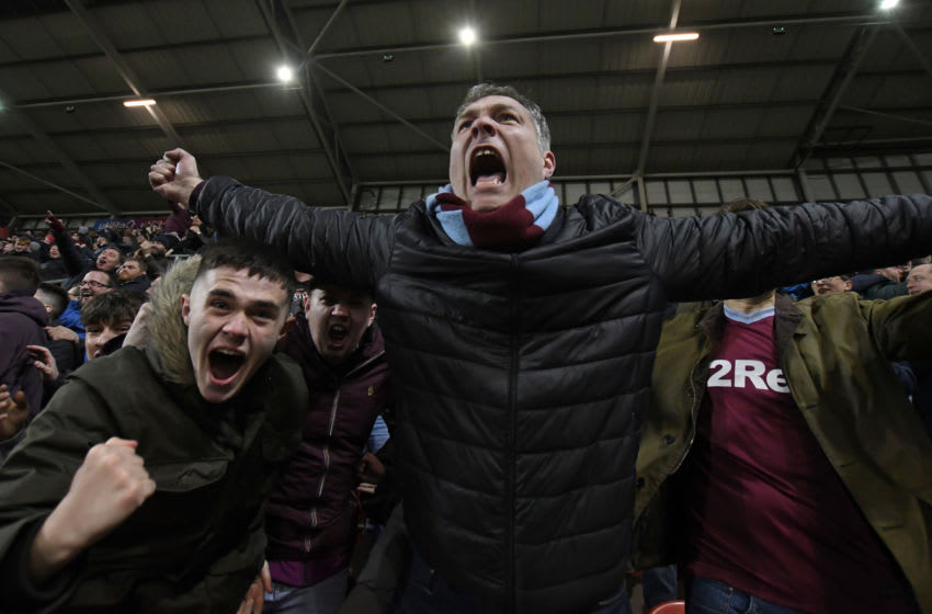 ROTHERHAM, ENGLAND - APRIL 10: Fans of Aston Villa celebrate a goal during the Sky Bet Championship match between Rotherham United and Aston Villa at The New York Stadium on April 10, 2019 in Rotherham, England. (Photo by George Wood/Getty Images)