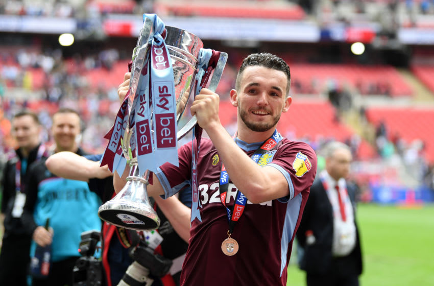 LONDON, ENGLAND - MAY 27: John McGinn of Aston Villa celebrates with the trophy following his teams victory in the Sky Bet Championship Play-off Final match between Aston Villa and Derby County at Wembley Stadium on May 27, 2019 in London, United Kingdom. (Photo by Mike Hewitt/Getty Images)