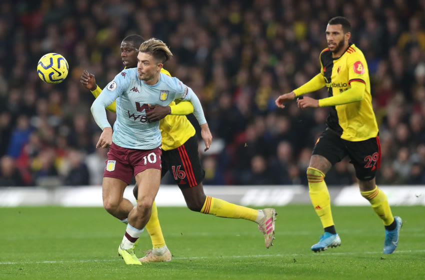 WATFORD, ENGLAND - DECEMBER 28: Jack Grealish of Aston Villa battles for possession with Abdoulaye Doucour of Watford during the Premier League match between Watford FC and Aston Villa at Vicarage Road on December 28, 2019 in Watford, United Kingdom. (Photo by Alex Morton/Getty Images)