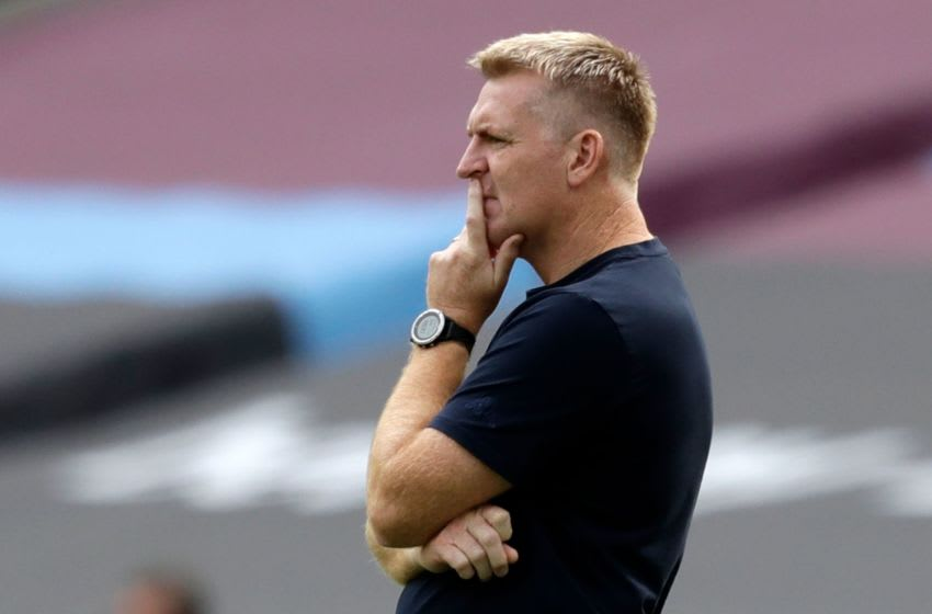 Aston Villa's English head coach Dean Smith looks on from the sidelines during the English Premier League football match between West Ham United and Aston Villa at The London Stadium, in east London on July 26, 2020. (Photo by Matt Dunham / POOL / AFP) / RESTRICTED TO EDITORIAL USE. No use with unauthorized audio, video, data, fixture lists, club/league logos or 'live' services. Online in-match use limited to 120 images. An additional 40 images may be used in extra time. No video emulation. Social media in-match use limited to 120 images. An additional 40 images may be used in extra time. No use in betting publications, games or single club/league/player publications. / (Photo by MATT DUNHAM/POOL/AFP via Getty Images)