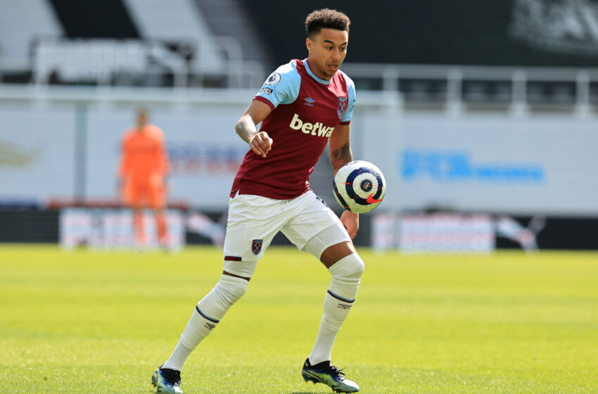 NEWCASTLE UPON TYNE, ENGLAND - APRIL 17: Jesse Lingard of West Ham United runs with the ball during the Premier League match between Newcastle United and West Ham United at St. James Park on April 17, 2021 in Newcastle upon Tyne, England. Sporting stadiums around the UK remain under strict restrictions due to the Coronavirus Pandemic as Government social distancing laws prohibit fans inside venues resulting in games being played behind closed doors. (Photo by David Rogers/Getty Images)