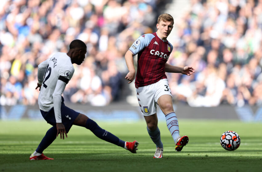 LONDON, ENGLAND - OCTOBER 03: Matt Targett of Aston Villa in action with Emerson Royal of Tottenham Hotspur during the Premier League match between Tottenham Hotspur and Aston Villa at Tottenham Hotspur Stadium on October 03, 2021 in London, England. (Photo by Marc Atkins/Getty Images)