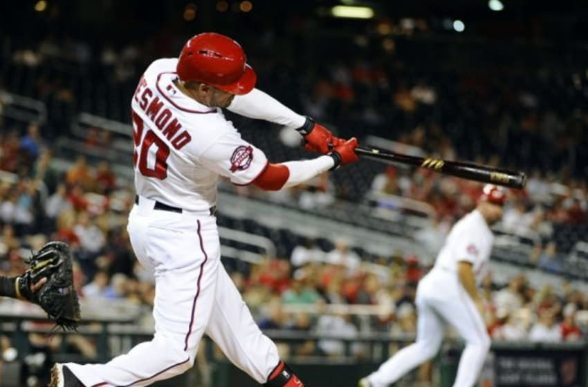 Sep 17, 2015; Washington, DC, USA; Washington Nationals shortstop Ian Desmond (20) hits a two run home run against the Miami Marlins during the second inning at Nationals Park. Mandatory Credit: Brad Mills-USA TODAY Sports